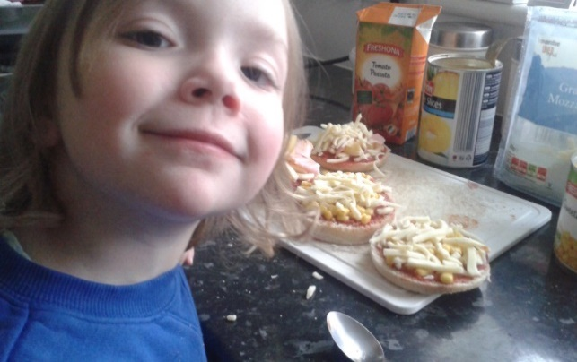 Jackie and Tilly cooking mini pizzas