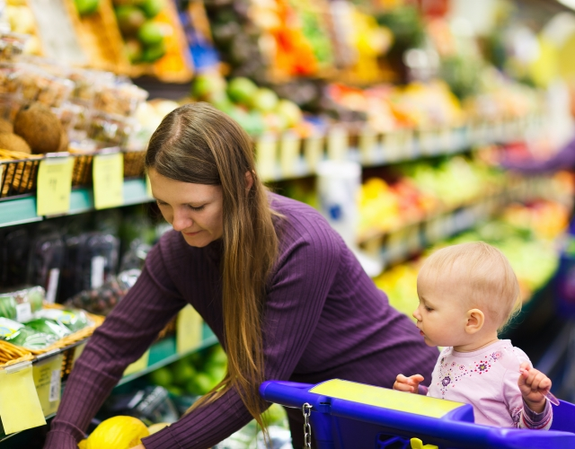 young mother shopping with her baby