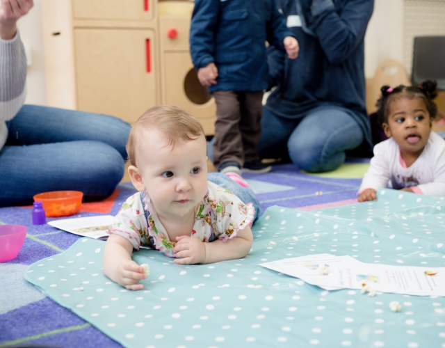 Children crawling at a HENRY group programme (feature)
