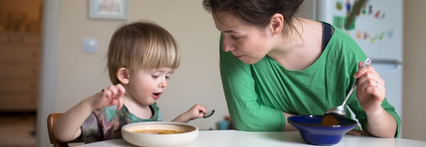 Woman and child eating together
