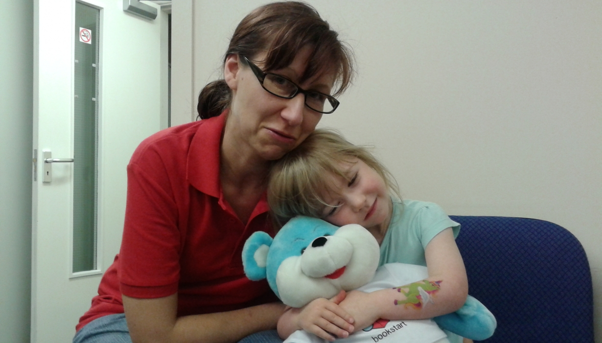 Amanda and daughter with teddy bear