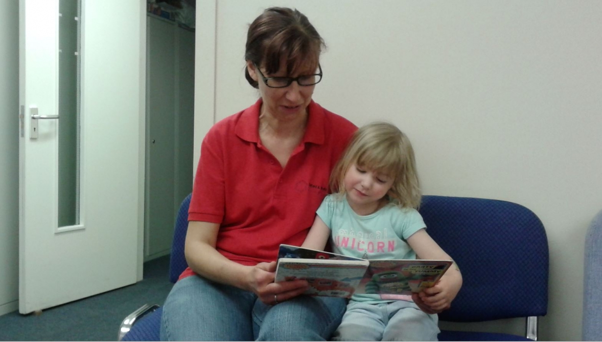 Amanda and daughter reading