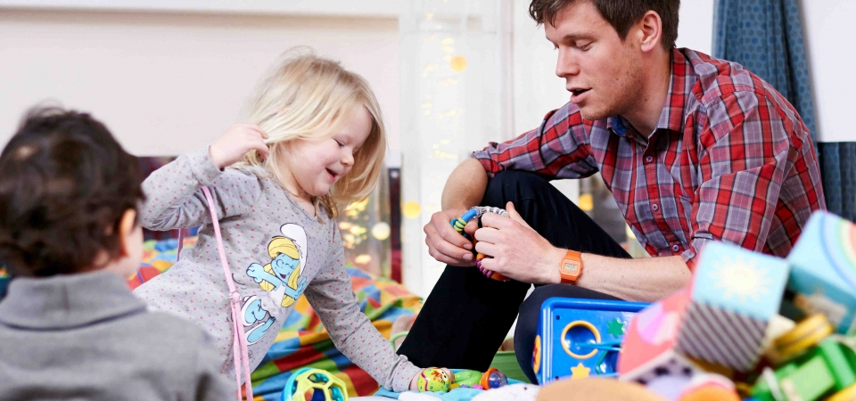 adult and children playing